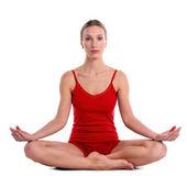 Oung mujer practicando yoga en la posición de loto — Foto de Stock