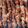 Grilled shish kebabs on skewers — Stock Photo