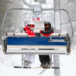 Skiers on a ski-lift — Stock Photo #11046415