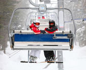 Skiers on a ski-lift — Foto Stock