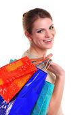 若い女性の笑顔運ぶ買い物袋の笑みを浮かべてください。 — ストック写真