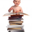 Portrait of a little boy with a stack of books — Stock Photo