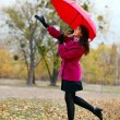 Young beautiful woman with umbrella in autumn park — Stock Photo