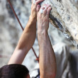 Closeup view of a rock climber's hands on a cliff — Stock Photo