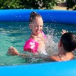 Kids having fun in the swimming pool — Stock Photo