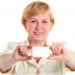 Smiling mature businesswoman holding blank empty business card or plastic card — Stock Photo