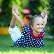 Cute four-year old girl exercising outdoors — Stockfoto