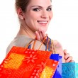 Portrait of a smiling young woman with shopping bags — Stock Photo