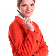 Young business woman holding pen, looking at camera and smiling — Stock Photo #11857000