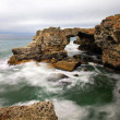 Rocky seashore on gloomy day, long exposure — 图库照片