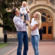 Caucasian couple with one-year old boy outdoors — Stock Photo