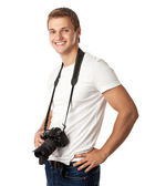 Portrait of a handsome young man with a camera — Stock Photo