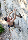 Rock climber focusing on the next movement — Stock Photo
