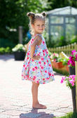 Cute four-year girl looking at camera outdoors — Stock Photo