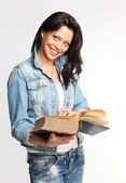 Portrait of a cheerful young woman reading a book — Stock Photo