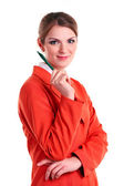 Young business woman holding pen, looking at camera and smiling — Stock Photo