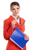 Youngc aucasian business woman holding glasses and a folder — Stock Photo