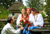 Young in Ukrainian clothes flirting — Stock Photo