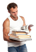 Caucasian man with a stack of books on white — Stock Photo