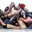 Pile of various female shoes isolated over white — Stock Photo #11888447