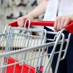 Woman pushing shopping cart in shoe store — Stock Photo #11955882