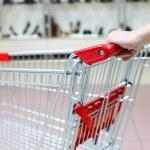 Woman pushing shopping cart in shoe store, close-up — Stock Photo #11955891