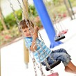 Little boy swinging on chain swing — Stock Photo #11309605