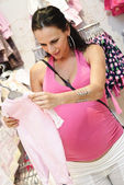 Yang pregnant woman doing shopping on Babyshop — Stock Photo