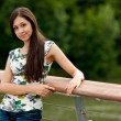 Young woman on a bridge — Stock Photo #11994215