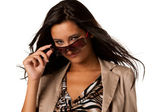 Beautiful woman looks over sunglasses — Stock Photo