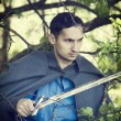 Man with medieval sword — Stock Photo #11004393