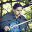 Man with medieval sword — Stock Photo