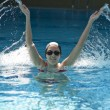 Woman trains synchronous swiming — Stock Photo #11088931
