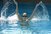Woman trains synchronous swiming — Stock Photo