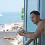 Young handsome man at hotel at tropics — Stock Photo #11420390