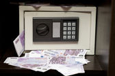 Steel electronic safe with money — Stock Photo