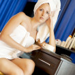 Young sexy woman in white towels — Stock Photo