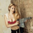 Royalty-Free Stock Photo: Blond woman with heavy drill
