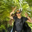 Young male tourists in tropical jungle — Stock Photo