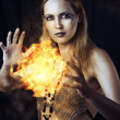 Stock Photo: Dangerous womwitch with fire ball