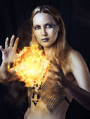 Dangerous woman witch with fire ball — Stock Photo