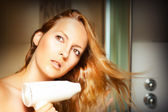 Beautiful woman drying her hair — Stock Photo