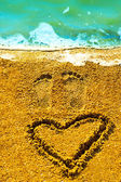 Male and female footprints in the sand — Stock Photo