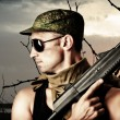 Handsome dangerous military man - Stock Photo