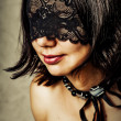 Royalty-Free Stock Photo: Sexy young woman with lace mask