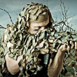 Stock Photo: Military Camouflaged mwith automatic