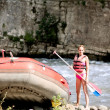 Water rafting, woman and raft boat — Stock Photo