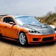 Orange sports car - Stock Photo