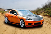 Orange sports car — Stock Photo