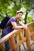Young man traveler with black backpack — Stock Photo